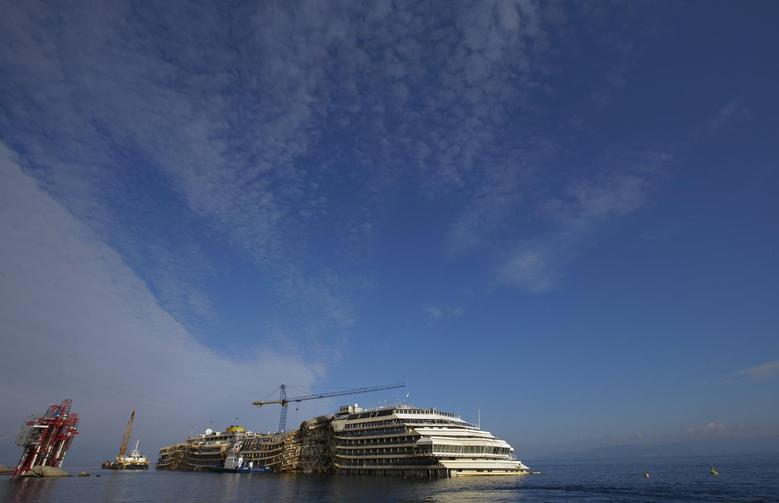 The Costa Concordia cruise liner is seen during the ''parbuckling'' operation outside Giglio harbour January 13, 2014. REUTERS/Max Rossi