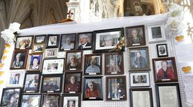 Pictures of victims of the Residence du Havre fire are displayed during a memorial ceremony at the Decollation-de-Saint-Jean-Baptiste church in L'Isle Verte, Quebec, February 1, 2014. REUTERS/Mathieu Belanger