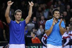 French players Jo-Wilfried Tsonga (R) and Richard Gasquet celebrate after defeating Australian players Lleyton Hewitt and Chris Guccione during their Davis Cup world group first round tennis doubles match in Mouilleron-Le-Captif, Western France, February 1, 2014. REUTERS/Stephane Mahe