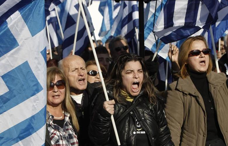 Supporters of far-right Golden Dawn party shout slogans during a rally against plans for the construction of the first official mosque at Votanikos suburb in Athens December 14, 2013. REUTERS/John Kolesidis