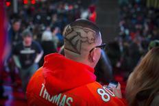 A fan with the Denver Broncos logo shaved in his hair is seen on Super Bowl Boulevard in Times Square, as part of the Super Bowl lead up in New York February 1, 2014. REUTERS/Andrew Kelly