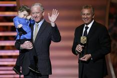 Former NFL quarterback Archie Manning (C) accepts the NFL MVP award for his son Denver Broncos quarterback Peyton Manning with Peyton's son Marshall as Joe Montana (R) holds the award during the NFL Honors award show in New York February 1, 2014. REUTERS/Carlo Allegri