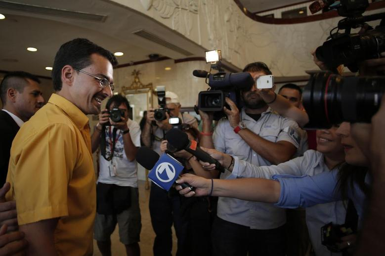 Jose Maria Villalta, presidential candidate from the leftist Broad Front Party, speaks to the media before a meeting with electoral observers in San Jose February 1, 2014, ahead of Sunday's elections. REUTERS/Juan Carlos Ulate
