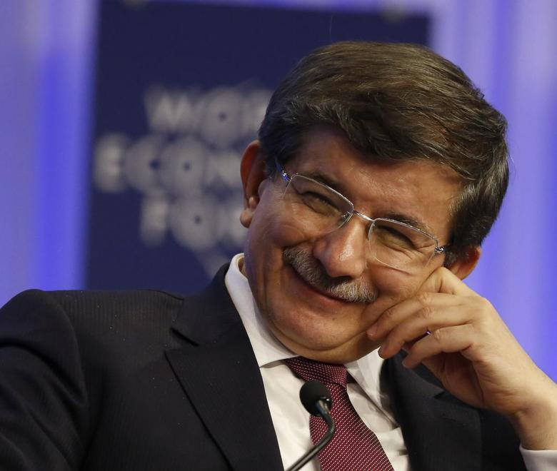 Turkish Foreign Minister Ahmet Davutoglu attends a session at the annual meeting of the World Economic Forum (WEF) in Davos January 24, 2014. REUTERS/Ruben Sprich