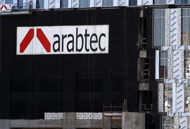 An Arabtec logo is seen on buildings under construction in the Marina area of Dubai in this picture taken November 28, 2009. REUTERS/Steve Crisp
