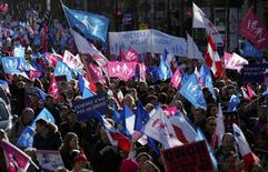 "People wave trademark pink, blue and white flags during a protest march called, ""La Manif pour Tous"" (Demonstration for All) against France's legalisation of same-sex marriage and to show their support of traditional family values, in Paris February 2, 2014. REUTERS/Benoit Tessier"