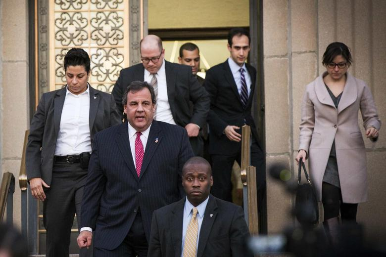 New Jersey Governor Chris Christie (second from front) departs City Hall in Fort Lee, New Jersey January 9, 2014. REUTERS/Lucas Jackson