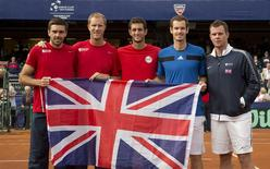 Feb 2, 2014; San Diego, CA, USA; Colin Fleming, Dominic Inglot, James Ward, Andy Murray and Captain Leon Smith (GBR) pose with the British flag after defeating the USA in their Davis Cup tie at Petco Park. Mandatory Credit: Susan Mullane-USA TODAY Sports