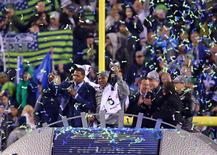 Feb 2, 2014; East Rutherford, NJ, USA; Seattle Seahawks outside linebacker Malcolm Smith (53) wins MVP in Super Bowl XLVIII against the Denver Broncos at MetLife Stadium. Jim O'Connor-USA TODAY Sports