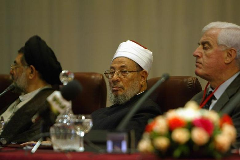 Egyptian-born cleric Sheikh Youssef al-Qaradawi (C) attends the opening session of the fifth International Al-Quds conference in Algiers March 26, 2007. REUTERS/Louafi Larbi