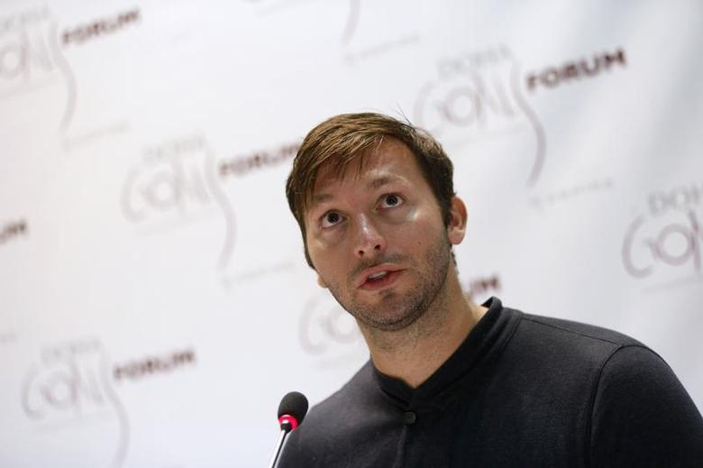 Five-time Olympic gold medalist Australia's Ian Thorpe speaks during the news conference for the Doha Gathering of All Leaders In Sport (GOALS) forum in Doha December 10, 2012. REUTERS/Fadi Al-Assaad