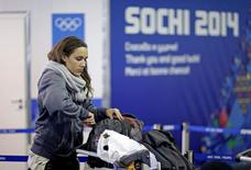 Women's bobsleigh brakeman Lolo Jones of the U.S. arrives at the Coastal Athletes Village for the 2014 Sochi Winter Olympics, January 30, 2014. REUTERS/David Goldman/Pool