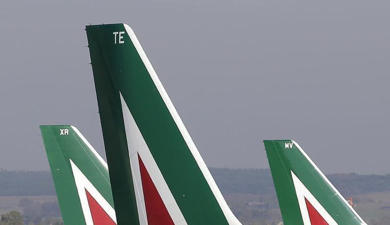 Alitalia planes are pictured before takeoff at the Fiumicino airport in Rome December 10, 2013. REUTERS/Max Rossi