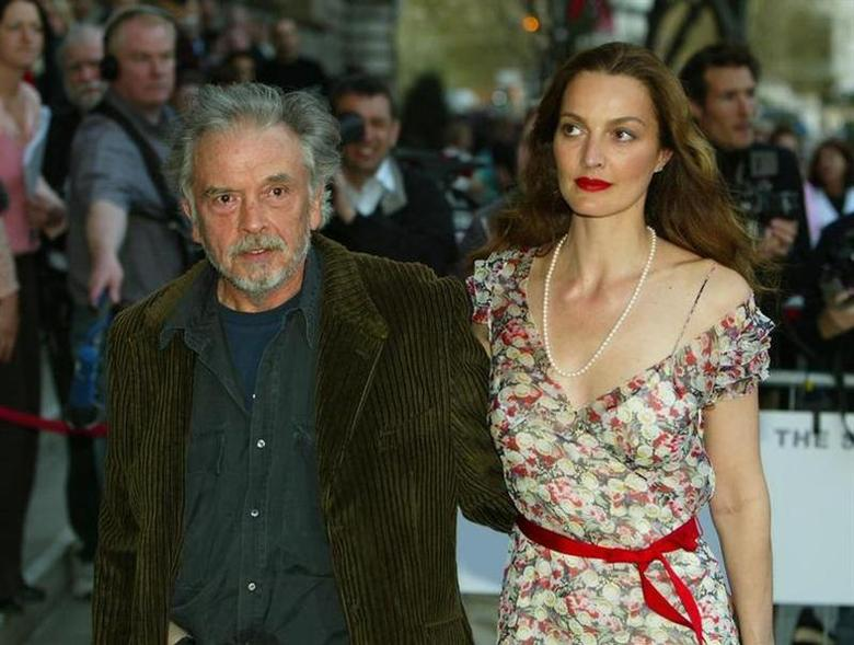 British photographer David Bailey (L) and his wife Catherine Bailey arrive for the opening of the new Saatchi Gallery in London, April 15, 2003. REUTERS/Peter Macdiarmid