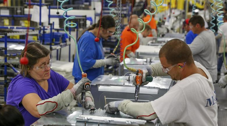 Workers assemble built-in appliances at the Whirlpool manufacturing plant in Cleveland, Tennessee August 21, 2013. REUTERS/Chris Berry