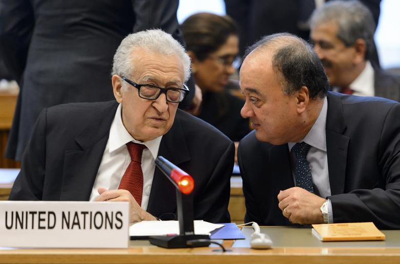 Lakhdar Brahimi (L), the U.N. envoy on Syria, speaks with his deputy Nasser Al-Kidwa before a meeting at the United Nations offices in Geneva December 20, 2013 file photo. REUTERS/Fabrice Coffrini/Pool