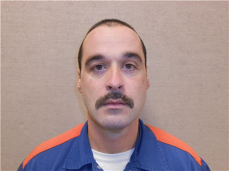 Michael David Elliot, 40, shown in this Michigan Department of Corrections photo, escaped from Ionia Correctional Facility in Ionia, Michigan on February 2, 2014. REUTERS/Michigan Department of Corrections/Handout