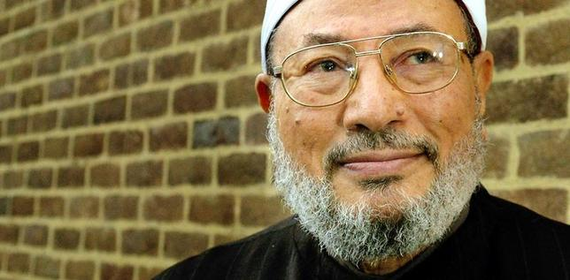 Professor Shaikh Youssef al-Qaradawi poses for photographs in London January 21, 2003. - RTXLQ7I