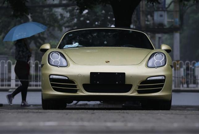A Porsche is parked at a parking lot of a shopping mall in the rain in Beijing June 5, 2013. REUTERS/Kim Kyung-Hoon
