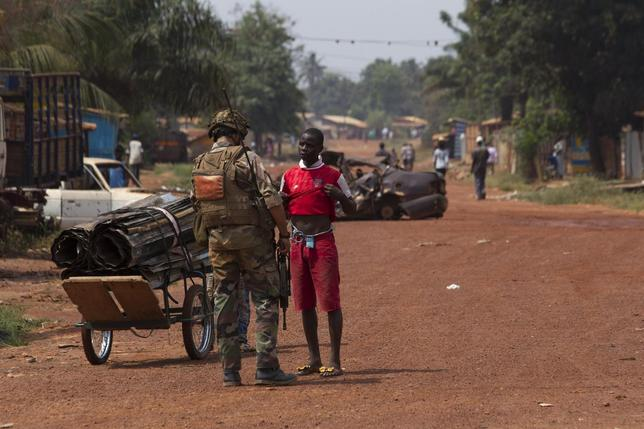 A French peacekeeping soldier searches a man for weapons in the district of Miskine of the capital Bangui February 3, 2014. REUTERS/Siegfried Modola