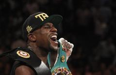 Floyd Mayweather Jr. of the U.S. celebrates his victory over WBC/WBA 154-pound champion Canelo Alvarez at the MGM Grand Garden Arena in Las Vegas, Nevada, September 14, 2013. REUTERS/Steve Marcus