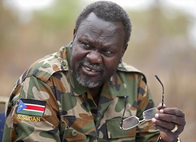 South Sudan's rebel leader Riek Machar speaks to rebel General Peter Gatdet Yaka (not seen) in a rebel controlled territory in Jonglei State February 1, 2014. REUTERS/Goran Tomasevic