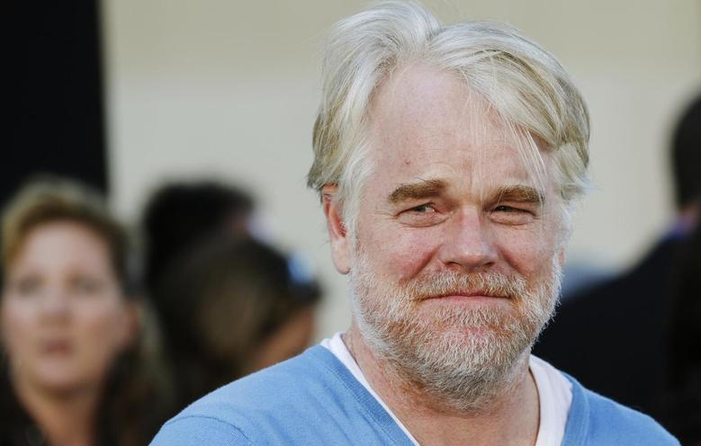 U.S. actor Philip Seymour Hoffman, who stars as Oakland Athletics' manager Art Howe, arrives for the world premiere of the film ''Moneyball'' in Oakland, California in this September 19, 2011, file photo. REUTERS/Robert Galbraith/Files