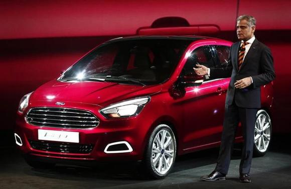 Kumar Galhotra, Vice-President, Engineering, Ford Motor Co, stands next to a Ford Figo global compact concept car at a press preview in New Delhi February 3, 2014. REUTERS/Adnan Abidi