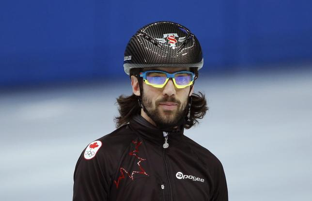 Short track speed skater Charles Hamelin of Canada practises in preparation for the 2014 Sochi Winter Olympics, February 2, 2014. REUTERS/Lucy Nicholson
