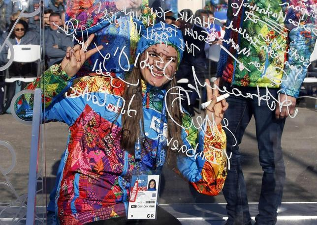 Russian pole vaulter and Mayor of the Coastal Cluster Olympic Village Yelena Isinbayeva gestures after signing the Olympic truce wall in Sochi, February 4, 2014. REUTERS/Eric Gaillard