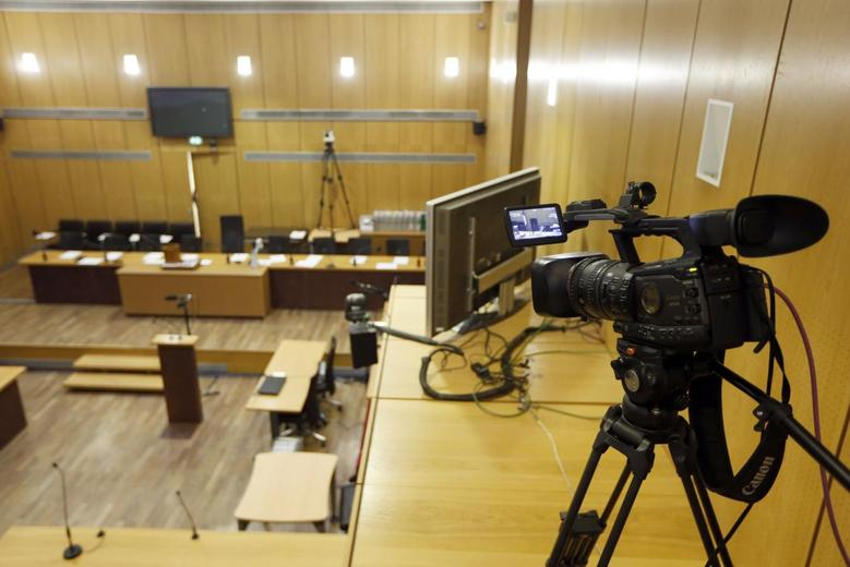 A camera which is set up to record exceptionally for archive the trial of former Rwandan army captain Pascal Simbikangwa is seen in a courtroom before the start of the trial at a Paris court February 4, 2014. REUTERS/Charles Platiau