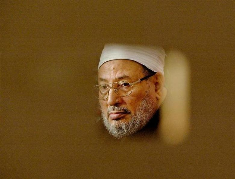 Professor Shaikh Youssef al-Qaradawi is pictured through a wooded partitian before giving an interview in London, January 21, 2003. REUTERS/Toby Melville