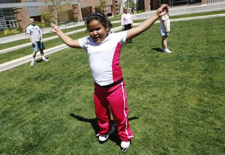 Fernanda Garcia-Villanueva, 8, does jumping jacks at a group exercise session in the 10-week Shapedown Program at The Children's Hospital in Aurora, Colorado May 29, 2010. REUTERS/Rick Wilking