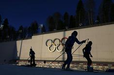 "Olympic skiers take part in a biathlon training session for the 2014 Sochi Winter Olympic Games at the ""Laura"" cross-country and biathlon centre in Rosa Khutor February 4, 2014 REUTERS/Carlos Barria"