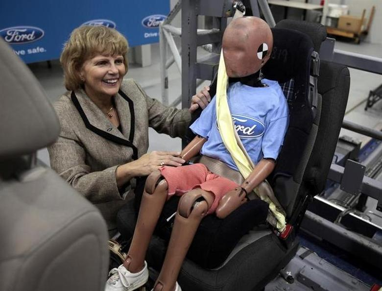 Ford Motor Vice President, Sustainability, Environment and Safety Engineering Sue Cischke shows off a child crash test dummy strapped in a Servo Sled Crash Simulator wearing seat belt air bags in Dearborn, Michigan November 5, 2009. REUTERS/Rebecca Cook