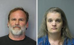 Dr. Melvin Morse, 58, and his wife Pauline, 40, are seen in this combination of booking photos released by the Delaware State Police August 9, 2012. REUTERS/Delaware State Police/Handout