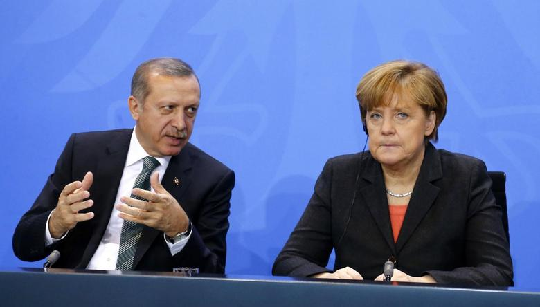 German Chancellor Angela Merkel and Turkey's Prime Minister Tayyip Erdogan address the media after talks in Berlin February 4, 2014. REUTERS/Tobias Schwarz