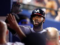 Atlanta Braves' Jason Heyward celebrates in the dugout after scoring on a single against the Milwaukee Brewers in the sixth inning at their MLB National League baseball game in Atlanta, Georgia September 24, 2013. REUTERS/Tami Chappell