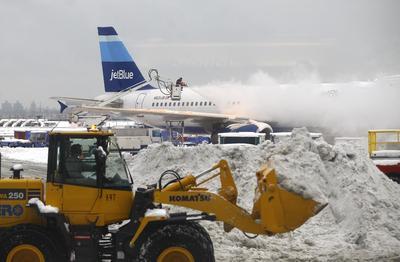 Storm slams Plains, Northeast braces for more snow
