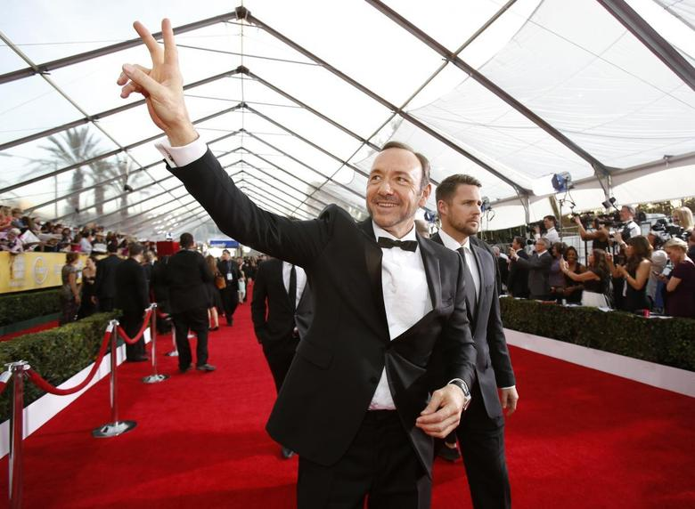 Actor Kevin Spacey, from the drama series ''House of Cards,'' arrives at the 20th annual Screen Actors Guild Awards in Los Angeles, California January 18, 2014. REUTERS/Mario Anzuoni