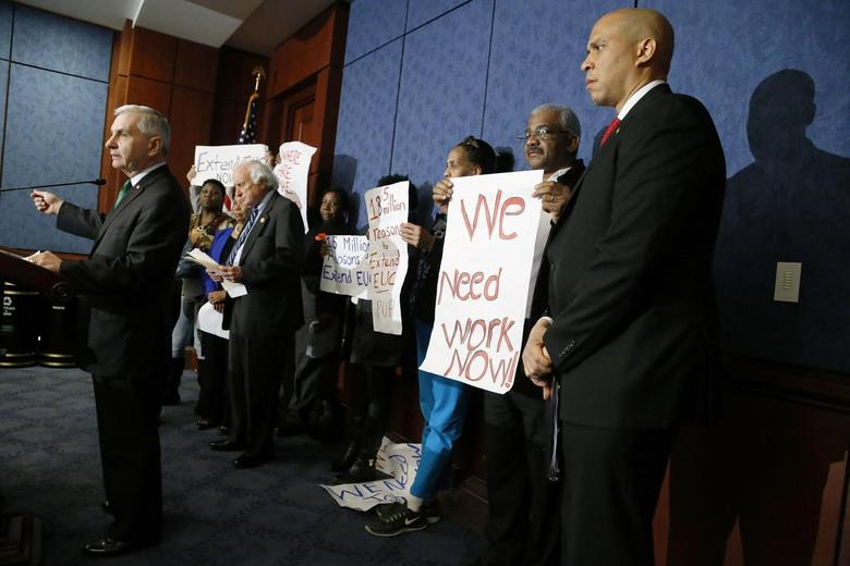 Senator Jack Reed (L) (D-RI) and U.S. Senator Cory Booker (D-NJ) hold a news conference with unemployed Americans to highlight their political divide with Republicans over unemployment insurance legislation, at the U.S. Capitol in Washington, January 16, 2014. REUTERS/Jonathan Ernst