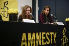 Russian punk rock band Pussy Riot members Nadezhda Tolokonnikova (R) and Maria Alyokhina hold a news conference in New York February 4, 2014. REUTERS/Shannon Stapleton