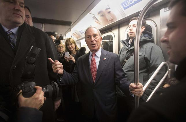 Outgoing mayor Michael Bloomberg rides the subway after he left City Hall for last time as Mayor of New York, on New Year's Eve in New York, December 31, 2013. REUTERS/Carlo Allegri