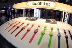 Swatch, leader mondial de l'horlogerie, s'attend à une solide croissance cette année après un bond de 20% de son bénéfice net, meilleur que prévu, en 2013. /Photo d'archives/REUTERS/Arnd Wiegmann