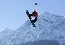 Canadian snowboarder Mark McMorris spins off a jump during slopestyle snowboard training at the 2014 Sochi Winter Olympics in Rosa Khutor, Russia February 5, 2014. REUTERS/Mike Blake