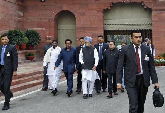 Prime Minister Manmohan Singh (in blue turban) arrives at parliament on the first day of the budget session in New Delhi February 21, 2013. REUTERS/B Mathur/Files