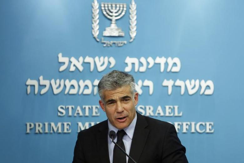 Israel's Finance Minister Yair Lapid speaks during a joint news conference with Prime Minister Benjamin Netanyahu, Bank of Israel Governor Stanley Fischer, Energy Minister Silvan Shalom and (not pirctured) in Jerusalem June 19, 2013. REUTERS/Baz Ratner