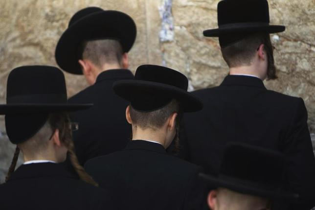 Ultra-Orthodox Jews take part in a morning prayer at the Western Wall, Judaism's holiest prayer site, in Jerusalem's Old City May 31, 2012. REUTERS/Ronen Zvulun