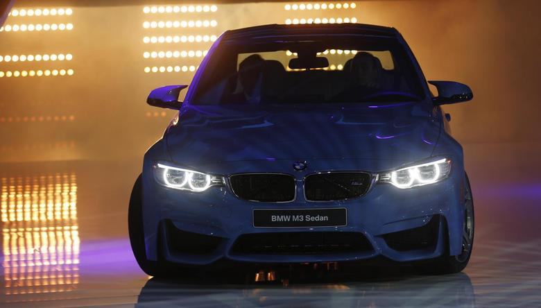 The BMW M3 sedan is rolled out during the press preview day of the North American International Auto Show in Detroit, Michigan January 13, 2014. REUTERS/Rebecca Cook