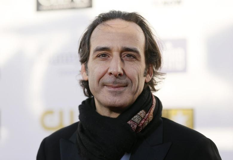 Composer Alexandre Desplat arrives at the 2013 Critic's Choice Awards in Santa Monica, California in this file photo taken January 10, 2013. REUTERS/Danny Moloshok/Files